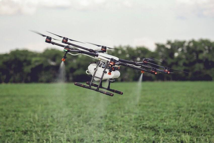 Agriculture drone fly to sprayed fertilizer on the rice fields.
