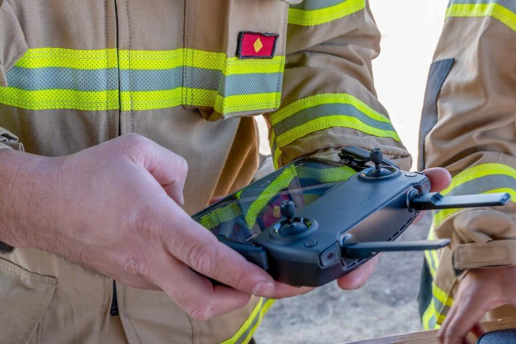 San Rafael, Argentina, July 14, 2020: firefighter operating drone in search and rescue.